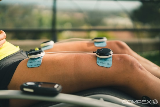 Athlete recovering with Compex Muscle Stim